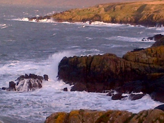 The crashing waves on the coast line near Dundream.